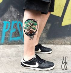 Water colored Calf Tree Tattoo. I have never seen such a clear and detailed tattoo ever. This amazing and beautifully done tree tattoo with water colors is great option for you, if you love trees.