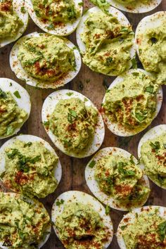 These are the creamy avocado deviled eggs of your dreams! These apps are loaded with healthy fats, low carbs, protein and love! Double the recipe, they won't last long! #avocadodeviledeggs #lowcarbavocadodeviledeggs