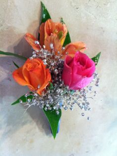 Colorful boutonniere with silver glitter spray accent