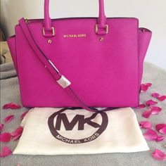 Michael Kors Large Selma Brand new with tags Michael Kors Large Selma in fuchsia. The bag is in perfect condition with no stains, rips, or tears, and is perfect for all seasons. 100% authentic. Includes dust bag, purse fillers, and extension strap.                                                                         ❌NO TRADES, LOWEST, OR HOLDS❌ Michael Kors Bags Satchels