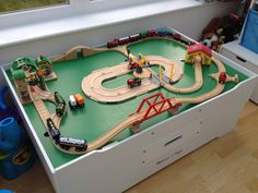 The trains are lining up to travel around the wooden train set, pass the Brio Speaking Station and Signal Station, before taking a short cut past the road system and level crossings.