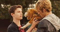 """Think she'll like it?"" Josh asks holding up the dog. ""I think she'll love it"" joseph replies"