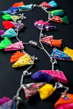NOTE: Simple to make, folded colorful fabric, with small tassels = dangle chain for curtain tie-backs. Thread Jewellery, Tassel Jewelry, Textile Jewelry, Fabric Jewelry, Ethnic Jewelry, Diy Jewelry, Handmade Jewelry, Jewelry Design, Jewelry Making