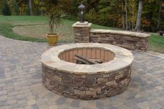 I love the big, permanent fire pit.  Doubles as seating for parties.  The stone they used is alright- i think it would even pair with slate, or a nice brick.