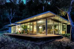 The house is situated on a beautiful oak covered slope to take maximum advantage of the view to the east, with sliding doors giving direct access to a wood deck.    Built by Canyon Construction.  Designed by Taalman Koch Architecture.  Photographed by Treve Johnson.
