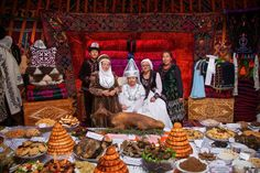Welcome guest, are you hungry? Photograph by Oliver Munoz - Inside a yurt camped 30 km. from Cholpon-Ata, in a jailoo called Kyrchyn. The hospitality of the nomads in Kyrgyzstan currently still very present, especially in the celebrations
