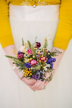 a vibrant bouquet of wildflowers for a simple just-picked-from-the-meadow posy. Besides the straw flowers, most of these can be dried beautifully. Very sweet!