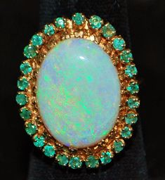 Elegant and Opulent Yellow Gold, Oval Opal and Emerald Ring, Not to fond of gold, but I'd love to have this beautiful piece! Opal Jewelry, I Love Jewelry, Jewelry Rings, Jewelry Accessories, Fine Jewelry, Jewelry Design, Jewlery, Antique Jewelry, Vintage Jewelry