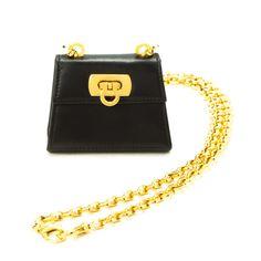 3b21e0d19a07  Ferragamo  Gancini black leather mini shoulder bag. Available at lxrco.com  for