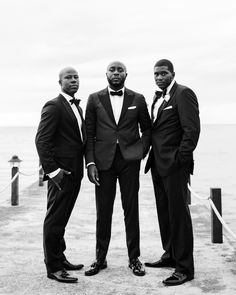 "After the ceremony, Terry posed on the pier with his two best men, Kwadwo ""Kay"" Yeboah-Acquah (left) and Gregory Kornegay. #groomsmen #groom #weddingparty #weddingtux 