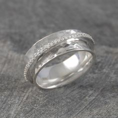 Silver and White Topaz Spinning Ring - An Otis Jaxon classic, now with added sparkle! This sterling Silver and White Topaz Spinning Ring is encircled with pave white topaz stones- certain to dazzle and impossible not to fiddle with! #Otisjaxon #Jewellery