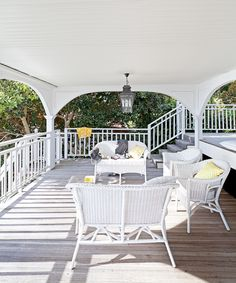 """**9. Laid-back living.** Wicker has become synonymous with Hamptons style. It is, more often than not, painted white to reflect light and keep the homes looking more beachy than country. This space, sheltered from the elements, is one of the homeowner's favourite spaces. """"We love the tiered deck area, which was our only structural addition, and how much of the house opens seamlessly onto it,"""" Jane says."""