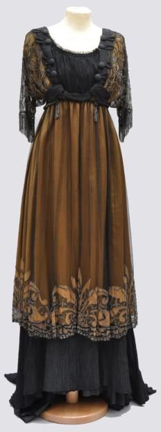 Robe satin bronze silk tunic and black tulle decorated with golden brown patterns, embroidered beaded steel lining and black taffeta pleated flounce around 1910 (via Robe satin bronze silk tunic and black tulle decorated)
