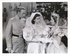 Vivian Leigh and Olivia de Havilland in the double wedding scene, Gone With the Wind: Those huge mutton chop sleeves on Scarlett and the weird netting head piece on Melanie still don't ruin this movie for us. Is this the most heart-breaking love triangle wedding ever? Poor, mealy-mouthed, soon-to-be-dead little Charles.