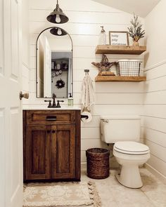 These rustic bathroom ideas will allow you to make a big impact with just a few elements. Check it now if you are a fan of rustic bathroom design! diy bathroom ideas Five Rustic Bathroom Ideas To Try At Home Downstairs Bathroom, Bathroom Wall Decor, Bathroom Interior, Modern Bathroom, Shower Bathroom, Farm House Bathroom, Bathroom Layout, Small Bathroom Redo, Bathroom Lighting