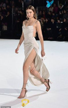 Off Shoulder Mini Ruched Dress Gigi Hadid flaunts her endless pins in a slinky gown on the runway of the Jacquemus PFW show | Daily Mail Online<br> The model, 24, showcased her endless pins in a slinky gown as she walked the runway for the Jacquemus Menswear Fall/Winter 2020-2021 show in Paris, France on Saturday. Gigi Hadid Runway, Kendall Jenner Runway, Gigi Hadid Walk, Gigi Hadid Looks, Bella Gigi Hadid, Gigi Hadid Style, Kendall Jenner Outfits, Couture Mode, Couture Fashion