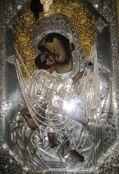"""The miraculous icon Panagia Glykophilousa, Mount Athos: Glykophilousa means Sweet-kissing"""" or """"Loving Kindness"""" icon depicts the Virgin Mary caressing her son, so that they appear to be kissing."""