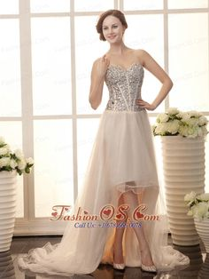 Champagne Tulle Rhinestone Decorate Bodice Sweetheart Neck Court Train 2013 Prom Gowns  http://www.fashionos.com  Sparkling glamorous this Champagne prom dress is! It features a strapless bodice with a sweetheart neckline and lovely shimmering beadings throughout that defines your figure. The pretty high-low skirt with layers of sheer tulle fabric contures your slim figure. A luminous court train and the lace up back completes this design.