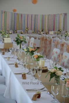 Stokeinteignhead village hall wedding Devon. Chair covers, sashes, hessian table runners and floral designs supplied by Wild Floral Designs.