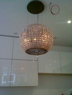 Divine chandelier amazing over an island in the kitchen home extractor fan aloadofball Image collections