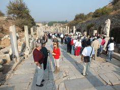 Guide Arzu on Epehsus Curetes street with clients