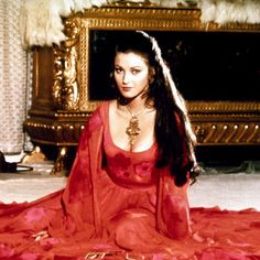 Jane Seymour as Solitaire in Live and Let Die - Jane's cascading locks were preternaturally on point in Live and Let Die. Whether they were fastened into an intricate updo or left long and loose, we'll never understand how she achieved such impressive volume.