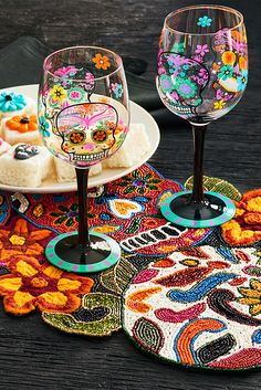 The perfect mix of colorful and creepy, Pier 1's Dia de los Muertos Painted Wine Glass features an intricate, hand-painted design. It's a fun way to toast the spooky spirit of the season.