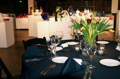 Navy table linens. Tulip centerpieces.