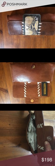 Reduced! Leatherock clutch. Great all leather cognac clutch with etched and python print detail. Perfect to transition to Fall. Fold over with single snap, envelope size.  Brand new with tissue inside holding shape. leatherrock Bags Clutches & Wristlets
