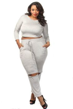 This cute plus size set features a solid long sleeve crop top, mid rise pants with slit knees. Soft, stretch material 95% Polyester 5% Spandex Model wearing 3X Made in USA