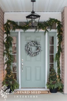 Christmas porch with evergreen boughs, light blue accent, wreath, and white lights - classic rustic Farmhouse style by Miss Mustard Seed Outside Christmas Decorations, Christmas House Lights, Christmas Porch, Farmhouse Christmas Decor, Rustic Christmas, English Christmas, Merry Christmas, Holiday Decor, Ranch Style Homes