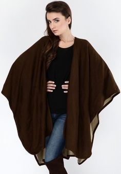 Look exceptionally smart and stylish when you wear this modish, poncho style jacket from the house of Femella. This reversible jacket will lend you different looks when paired with a woollen top and jeans. You can also wear this with top, woollen leggings and boots.