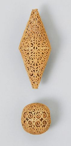 Syria or Egypt  | Two beads; gold, fabricated from wire and strips of sheet, decorated with granulation. | ca. 11th century, Fatimid