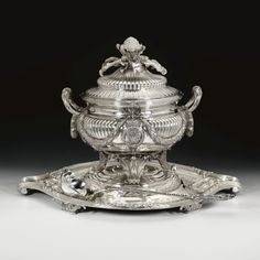 A George III silver soup tureen, cover, liner, stand and ladle, Thomas Pitts for Parker & Wakelin, London, 1768