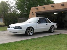 white 5.0L fox mustang w/18x9s in rear with 285/35s & 18x8s with 235/40s in the front.