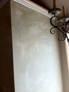 Ok, well, I painted this.....I wanted it to look like old plaster walls with many layers of color. I am pleased with how it turned out. This is before it was waxed.