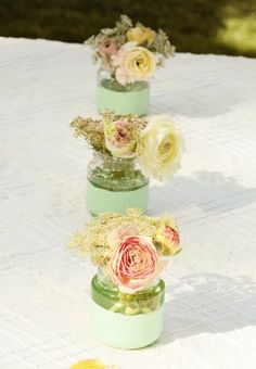 """""""I created a bunch of DIY projects in these colors, but my favorite was partially dipping baby food jars in mint craft paint as a floral arrangement for each place setting,"""" Becca Gorski of Cake Event Jar Centerpieces, Baby Shower Centerpieces, Baby Shower Decorations, Wedding Decorations, Baby Jars, Baby Food Jars, Food Baby, Mint Paint, Baby Food Jar Crafts"""