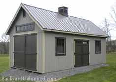 12'x36' New England Shed with 8'x8' transom barn door, ramp, gable vents, additional windows, transom windows, flower boxes and tall double transom entry door
