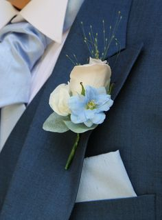 Blue Wedding Flowers The Groom's Men's Boutonnieres included a Mentha Rose with Sweet Peas and blue Delphinium florets Blue Corsage, Prom Corsage And Boutonniere, White Boutonniere, Blue Bouquet, Corsages, Prom Flowers, Blue Wedding Flowers, Bridal Flowers, Wedding Bouquets