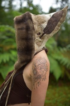 wet felted hat - don't dig the fur lining, but I like the feather embellishment