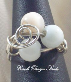 Sterling Silver wire wrapped ring with three white glass beads are perfect for any season. #etsy #handmade #design #gifts