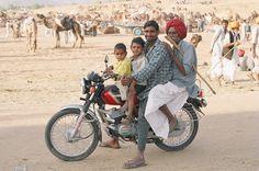 https://flic.kr/p/4wFaUk   Family on a motorbike, Puskar Camel Fair, Rajasthan, India