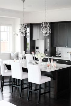 Black cabinets white counters, chairs, walls