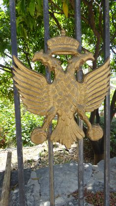 In heraldry and vexillology, the double-headed eagle is a charge associated with the concept of Empire. In modern Greece it appears in official use in the Hellenic Army (Coat of Arms of Hellenic Army General Staff) and the Hellenic Army XVI Infantry Division.  Kassiopi, Greece. Hellenic Army, Army Coat, Double Headed Eagle, Entrance Ways, Coat Of Arms, Arches, Division, Greece, Empire
