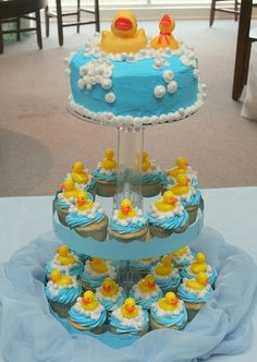 I can't believe how cute this cake & cupcakes are!!! Rubber Duckie Baby Shower by callie