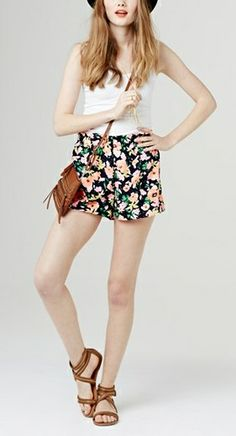 Love the combo of the crossbag with the floral shorts!