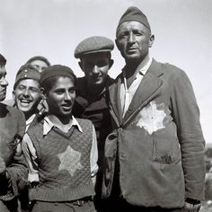 Jewish survivors of the Nazi concentration camps in Europe still wear the signs of their ordeal on their tattered clothing at the new immigrants' reception camp November 4, 1944 at Atlit, during the British Mandate of Palestine.