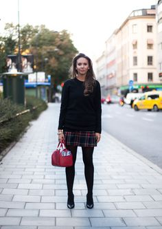 tartan skirt and a black jumper outfit ootd street style