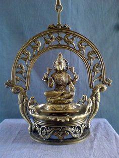 A hanging Goddess Lakshmi Lamp