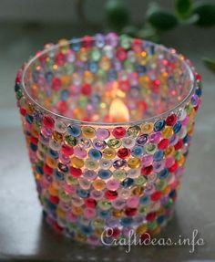 Colorful Beaded Votive Glass.  - clean and empty glass votive glass of choice  - jewelry glue  - assorted clear acrylic half beads